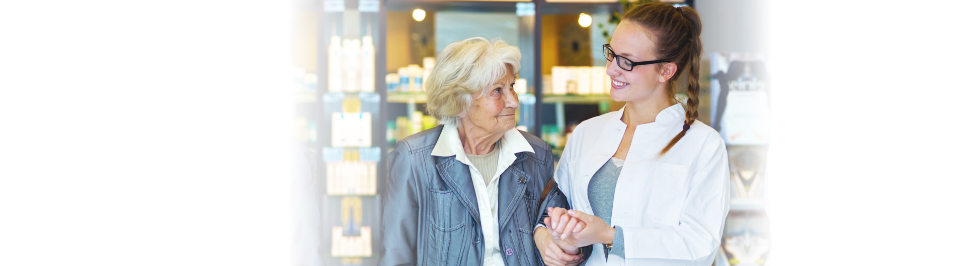 pharmacist assisting old woman